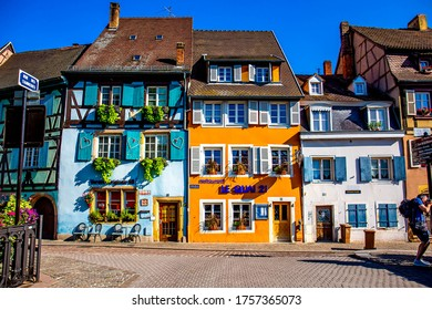 COLMAR, FRANCE - AUGUST 24, 2019 :: Landscape of half-timbered houses and shops along canal in old town Colmar. A famous destination for traveller in France.