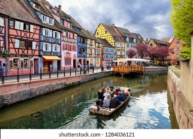 Colmar, France. Boat with tourists on canal in Little Venice (la Petite Venise) area