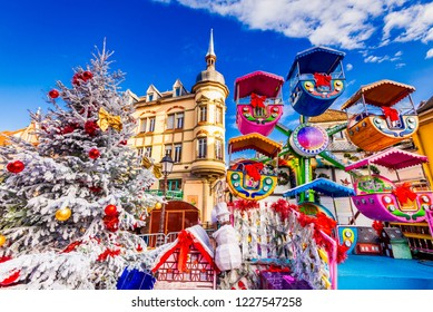 Colmar, France. Christmas Market in Place des Dominicians, traditional Alsatian half-timbered Xmas decorated city in Alsace.