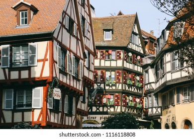 COLMAR, FRANCE - CIRCA MARCH 2018: Facades of traditional buildings in the old town of Colmar.