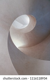 COLMAR, FRANCE - CIRCA MARCH 2018: Spiral concrete staircase inside the new extension of the Unterlinden Museum in Colmar, designed by architects Herzog & de Meuron