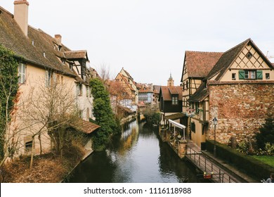 """COLMAR, FRANCE - CIRCA MARCH 2018: Traditional buildings in the """"Little Venice"""" area in the old town of Colmar."""