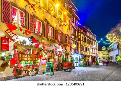 Colmar, France - December 2017. Traditional Alsatian half-timbered houses Christmas decorated city in Alsace.