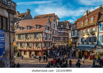 Colmar / France - December 25 2017: Tourists enjoy Christmas holidays in Grand Rue and in Rue des Marchands, in the afternoon.