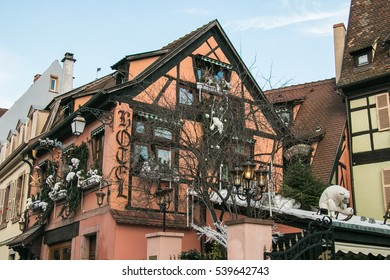 COLMAR, FRANCE - DECEMBER 9, 2016: Traditional half timbered houses of Colmar with christmas decorations