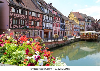 Colmar, France - July, 12, 2018: Colorful traditional french houses in the centre of the town