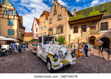 Colmar, France - July 27, 2018: Old town of Colmar, Alsace, France. View with colorful buildings, canal and flowers. Colmar, France. Petite Venice, water canal and traditional half timbered houses.