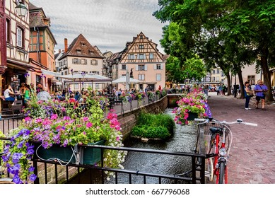 COLMAR, FRANCE - JUNE 14, 2017 -   Colorful traditional french houses on the side of river Lauch in Petite Venise, Colmar, France