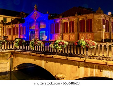 COLMAR, FRANCE - JUNE 14, 2017 - Beautiful view of the French city at night with illuminated streets and colorful houses in the neighborhood of the small Venice