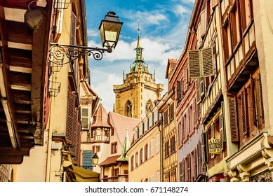 COLMAR, FRANCE - JUNE 15, 2017 -   View of the city  colmar in france famous for its colorful houses and small streets along the river and the gigantic Gothic cathedral