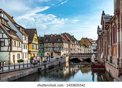 Colmar, France - June 4, 2019: Colorful traditional french houses on the side of river Lauch in Petite Venise, Colmar, France