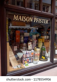 COLMAR, FRANCE - MAY 1, 2018: Wide view of a storefront with multiple liqours such as rums, cognac, and Scotch Single Malt whisky, on display. Alsace Wine Route. Travel and tourism