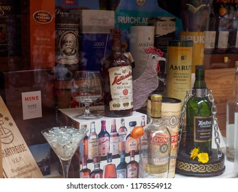 COLMAR, FRANCE - MAY 1, 2018: Closeup of a storefront with multiple liqours such as rums, cognac, and Scotch Single Malt whisky, on display. Alsace Wine Route. Travel and tourism