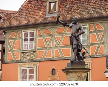 COLMAR, FRANCE - MAY 1, 2018: Closeup detail of a bronze statue of Lazarus von Schwendi, lord of Colmar, by his fountain near medieval timber buildings. Travel and landmarks.