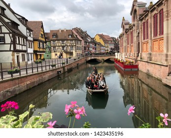 Colmar, France - May 19 Traveller sit on a wooden boat for watching view the Colmar old town at Colmar(Little Venice) taken May 19 2019 in Colmar