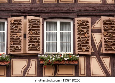 Colmar, France - May 27, 2012: A baker window decorated with baking products on a traditional half timbered house, Colmar,  France