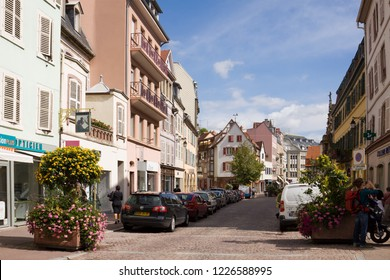 COLMAR, FRANCE - SEPTEMBER 10, 2010: An ancient street in the old town of Colmar city. Colmar is the capital of the Haut-Rhin department in Alsace. It is situated along the Alsatian Wine Route.