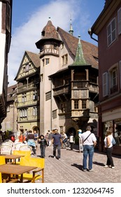 COLMAR, FRANCE - SEPTEMBER 10, 2010: An ancient lane in the old town of Colmar city with the famous Renaissance house (1537) known as Maison Pfister.
