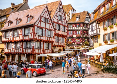 COLMAR, FRANCE - September 10, 2017: Cityscaspe view on the old town with beautiful half-timbered houses and crowded streets in Colmar, famous french town in Alsace region