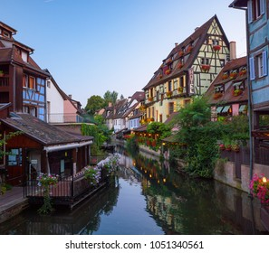 COLMAR, FRANCE - SEPTEMBER 2016: Beautiful view of the historic town of Colmar, also known as Little Venice. Amazing traditional colorful houses located on idyllic river Lauch, Colmar, Alsace, France