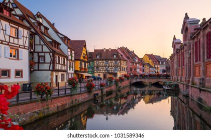 COLMAR, FRANCE - SEPTEMBER 2016: View of the historic town of Colmar, also known as Little Venice. Amazing traditional colorful houses located on idyllic river Lauch, Colmar, Alsace, France