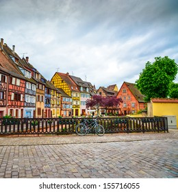 Colmar, Petit Venice, bridge on water canal, bike and traditional colorful houses. Alsace, France.
