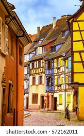 Colmar, Petit Venice, narrow street and traditional half timbered colorful houses. Alsace, France.
