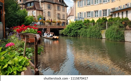 Colmar/France - June 09 2018: Stately ancient buildings and houses surrounded by many flowers, water canals and greenery. Not surprisingly, it is called Little Venice.