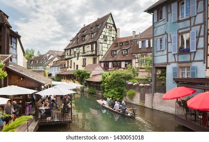 Colmar/France - May 26, 2019: The little Venice of Colmar - is a picturesque old tourist neighborhood with beautiful canals and traditional half-timbered houses. Colmar, Haut-Rhin, Alsace, France.