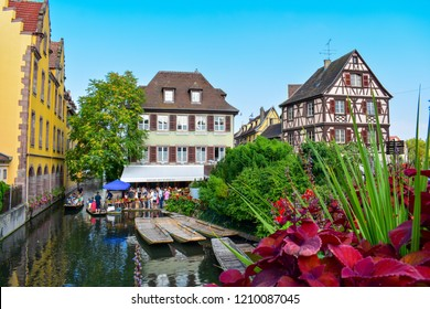 Colmar,France-Aug 18,18 : Beautiful view of the historic town of Colmar, also known as Little Venice, with tourists taking a boat ride along traditional houses on river Lauch, Colmar, Alsace, France