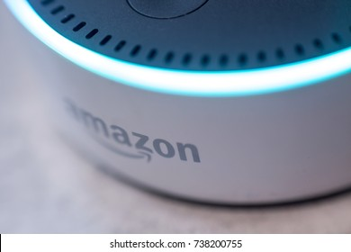 COLNE: October 20, 2017: Amazon Echo, Alexa voice recognition device, photograph taken close-up with the blue activation light on