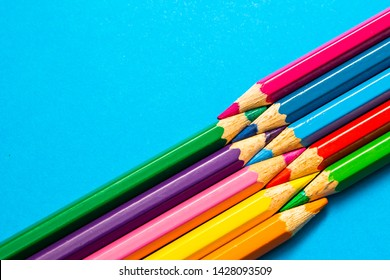 Coloful pencils on blue background, abstract design and color, back to school stationery backdrop