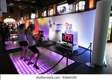 COLOGNE - AUGUST 16: Female videogamers playing with Kinect and Dance Central 2 at GamesCom 2011, the most important European video games Expo August 16, 2011 in Cologne, DE
