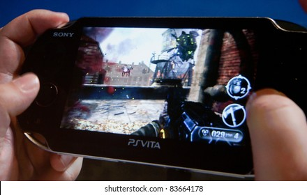 COLOGNE - AUGUST 16: PSVita or PlayStation Vita at GamesCom 2011, the most important European video games Expo August 16, 2011 in Cologne, DE