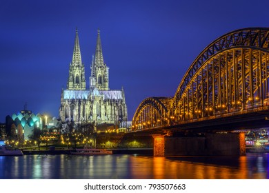 Cologne Cathedral (Dom) and Hohenzollern Bridge at blue hour