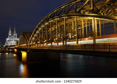 Cologne Cathedral and Hohenzollern Bridge during the blue hour. Panorama from Cologne.