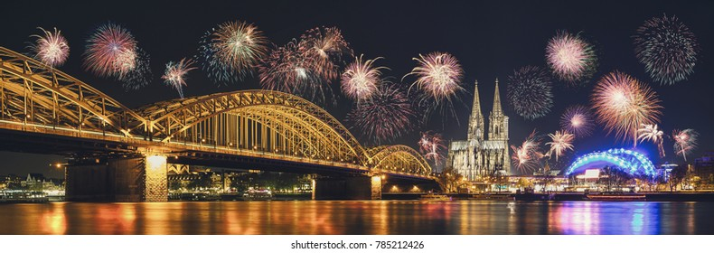 Cologne Cathedral and Hohenzollern Bridge with Fireworks on New Year day, Cologne, Germany
