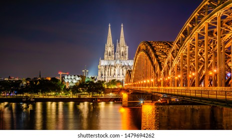 Cologne with Cologne Cathedral, Hohenzollern Bridge and Rhine at night