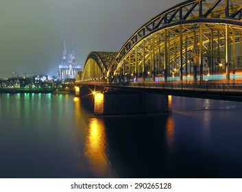 Cologne Cathedral and iron Bridge at night in Cologne, Germany