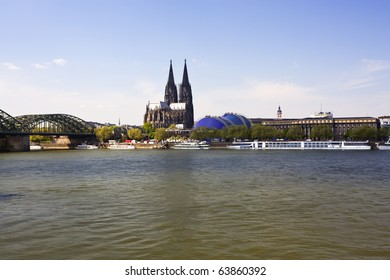 cologne cathedral and musical dome with the river rhine in foreground
