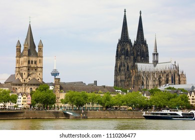 Cologne Cathedral and St. Martin church on river Rhine, Cologne, Germany