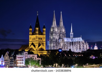 Cologne Cathedral, Groß St Martin church with view of the old buildings at the Cologne fish market by night. Blue Hour.