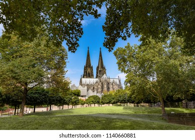 Cologne Cathedral with trees in foreground