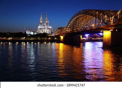 Cologne city night skyline, Germany. Rhine river, Hohenzollern bridge, and the Cathedral.
