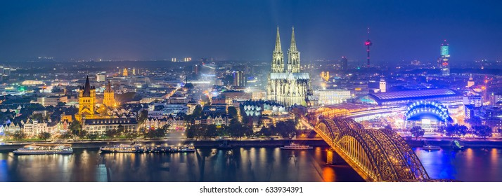 Cologne City, Panorama Landmark Beautiful Aerial View of Hohenzollern Bridge over Rhine River, Great St. Martin Church, Colonius TV-tower, Cologne Cathedral, MediaPark skyline in Summer Night, Germany