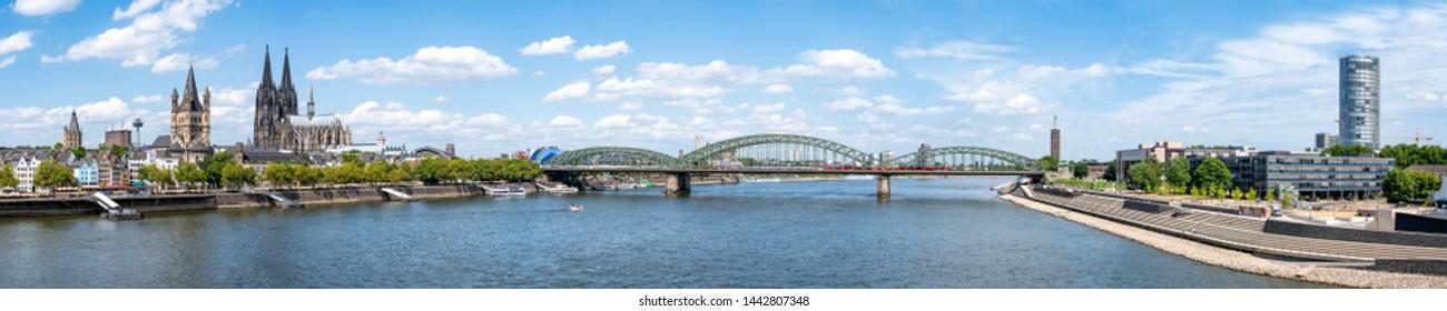 Cologne city skyline along the Rhine river with Hohenzollern Bridge, North Rhine-Westphalia, Germany