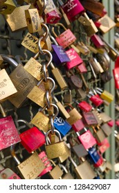 COLOGNE - DEC 1: Lockers at the Hohenzollern bridge on DEC 1, 2012 in Cologne. Since 2008 people have placed love padlocks on the fence between the sidewalk and the tracks symbolizing forever love.