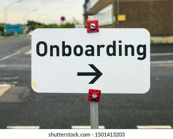 "Cologne, Germany - 2 September 2019: Sign ""Onboarding"" with arrow to the right side"