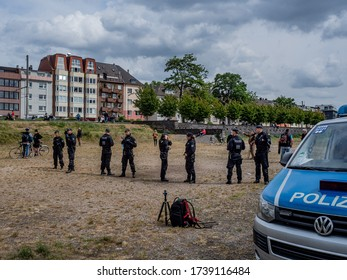 Cologne, Germany, 23 May 2020. Leftist counter-demonstration confronting protest against Corona virus restrictions being blocked off by police.