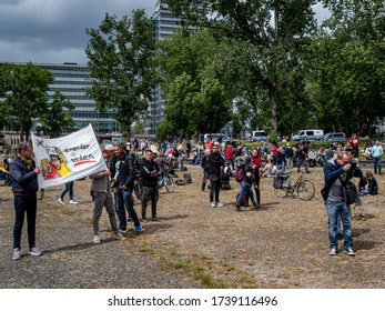 Cologne, Germany, 23 May 2020. Individuals with signs at public demonstration against Corona virus restrictions.